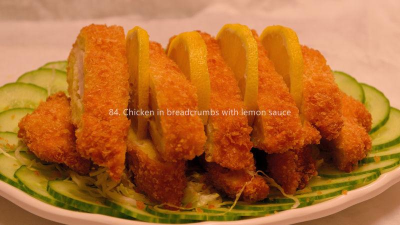 Chicken in breadcrumbs with lemon sauce