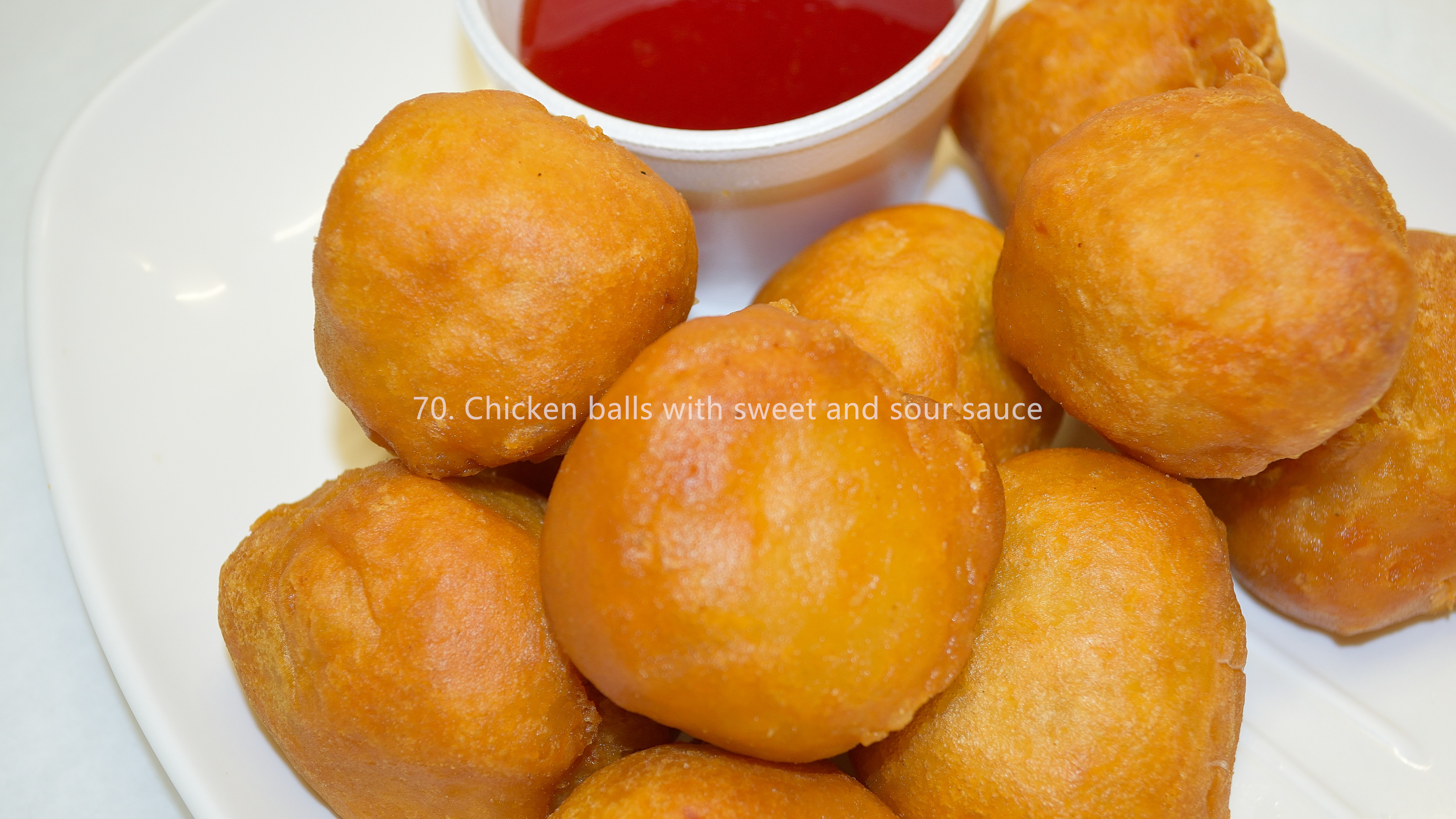 Chicken balls with sweet and sour sauce
